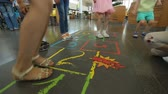 Kids having fun playing hopscotch