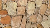 se movendo para cima : Slow panorama movement stone wall close-up. Slowly pan moving masonry closeup. Clear place for your isolated text. Empty space for your title copy space. Copyspace logo to blank design 4k macro.
