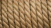 skein : Rotation coil brown color in form of spiral closeup. Rope background for design. Clear place for your isolated text pattern. Empty space for your title copy space. Copyspace logo to blank design.