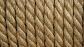skein : Panning coil brown color in form of spiral closeup. Rope background for design. Clear place for your isolated text pattern. Empty space for your title copy space. Copyspace logo to blank design. Stock Footage