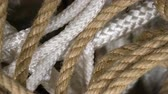 skein : Rotation set rope of brown, white in form spiral closeup. Rope background design. Clear place for your isolated text pattern. Empty space for your title copy space. Copyspace logo to blank design.