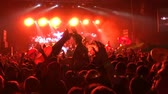 stadyum : Inflatable mattresses and toys are floating at the concert crowd-surfing. Drive and energy on the background of the scene at a rap or rock party. Lifebuoy. Bright beautiful light on the stage 4k. Stok Video