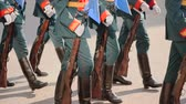 conserva : platoon military army marche street slowmotion. Parade military men demonstrate army rifles closeup slow mo step into rhythm. Soldier army uniform with machine gun hand close up marching formation