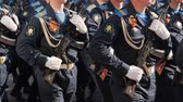 gyalogság : platoon military army marche street slowmotion. Parade military men demonstrate army rifles closeup slow mo step into rhythm. Soldier army uniform with machine gun hand close up marching formation