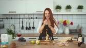 picada : Smiling Ginger Woman Cooking Fresh Meal in Kitchen. Cheerful Girl in Apron Throwing Chopped Pear in Glass Bowl Slow Motion. Homemade Fruit Dessert from Recipe Book Preparation. Footage Shot in 4K