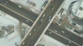путь : Big traffic of cars at a gray intersection. Transport travels swiftly along a long road. Shooting from quadrocopter. The landscape is breathtaking. Lights of foggy city beautifully complement picture. Стоковые видеозаписи