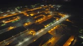 cargo container : Quadrocopter removes warehouse space from above, which are decorated with beautiful flashlights. The landscape is breathtaking. Lights of the night city beautifully complement the big and nice picture Stock Footage