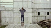 depresja : Man tired life pulling loop around neck closeup make suicide on gallow 4K. People stand stool to hang himself on gallow from depression in life. Guy committing suicide with loop rope from bankruptcy.