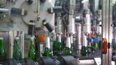 пробка : Factory for the production of champagne. Wrapping aluminum foil bottle neck with champagne. Bottles with champagne are moving along the conveyor belt. Ambient sound at clip.