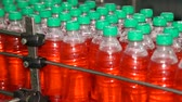 sopro : Production line for bottling bottles. Bottling of juice in plastic bottles. Stock Footage