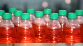 molding : Bottling of juice in plastic bottles. Lemonade bottle conveyor industry. Stock Footage