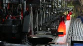 şarapçılık : Test run of machine for the production of glass wine bottles. Manufacture of a wine bottle. Manufacture of glass bottles. Factory for the production of bottles, glass plant. Ambient sound at factory.