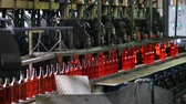 smelting : Factory for the production of bottles, glass plant. Manufacture of glass bottles. Production bottles in glass factory. Beer bottle production. Bottle manufacturing technology. Cinematography.