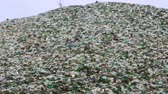 recyclable : Mountain of glass broken multicolored bottles. Glass broken bottles in recycling industry factory. Crushed of recycled glass bottles at factory. Recycling of waste from glass bottles. Panning. Stock Footage