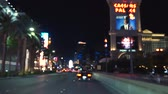 нечеткий : Las Vegas strip driving shot at night. POV Driving in Las Vegas - 4K. Auto rides down the main street in Las Vegas. Blurred focus. Background video.