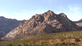 kaktüs : Red Rock Canyon Las Vegas Nevada, Panorama view. Dolly moving - Red Rock Canyon Nevada. Tourists on cars drive along the road of the reserve. Scenic Red rock canyon landscape. Stok Video