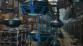 ремень : Tires on the conveyor in the tire pressing shop. Large car tire factory. Tire blanks move on the conveyor through the shop. Ceiling conveyor works on the forming workshop on tires plant. Стоковые видеозаписи