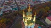 barok : Aerial top view of Saint Andrew. Kiev, Ukraine, Andriyivskyy Descent street and the domes of St Andrew. Fly around St. Andrews Church in Kiev. Drone flying over Church of St. Andrew at sunset. Wideo