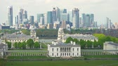 spojené království : Greenwich and Canary Wharf view from Observatory hill. Canary Wharf buildings at day time. Canary Wharf is site of tallest buildings and a major financial center in London.