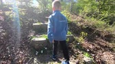 boy climbing a stone stairs in the woods