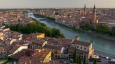 trafik : Verona, Italy. Cityscape of houses in the old town and the Adige River. 4K, UHD Stok Video