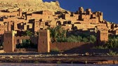 kasbah : Stone towers and buildings in ksar of Ait-Ben-Haddou - an ancient fortified village along the former caravan route between the Sahara and Marrakech in present-day Morocco. Sunset time.