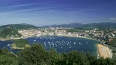 concha : Panorama of boats, beaches and the city at the Bay of Biscay in San Sebastian, Basque Country, Spain. Summer landscape with blue skies, green lush flora and a coast of the Atlantic ocean.