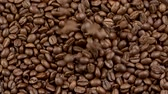 кофе : Falling coffee beans. Slow motion shot Стоковые видеозаписи