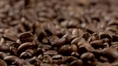 natural drink : Slow motion shot of falling coffee beans