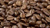 yiyecek ve içecek : Coffee beans background. Close up shot of rotating roasted coffee beans. 4K, UHD