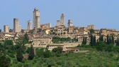 toscana : Panorama of San Gimignano towers. Shot from outside of town walls. San Gimignano, Italy is a small Medieval town in Tuscany. It is famous for great number of towers in it. 4K