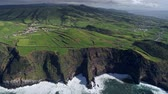 san miguel : Flying over a coast of Sao Miguel Island in the Azores, Portugal. The island is volcanic and is located in Atlantic ocean. Oftentimes it is called The Green Island. Aerial shot, UHD