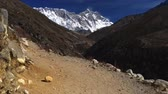 Nepal. Walking the Everest Base Camp Trek. Snowy Mount Everest is seen in the background. 4K