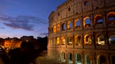 Colosseum in Rome, Italy. Panning illuminated early morning shot. 4K, UHD