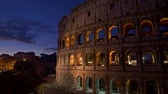 Rome, Italy. Illuminated Colosseum after sunset. Panning shot, UHD Stock Footage