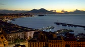 Naples, Italy. View of the city before sunrise. Vesuvius volcano is seen in the background. Panning shot, UHD