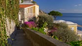 Elegant villa surrounded by flowers on the Amalfi coast in Positano village, Italy. The village is located at the coast of Tyrrhenian Sea. UHD Stock Footage