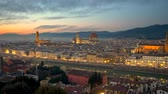 Florence after sunset, Italy. Night view of illuminated Florence old city center with sunset sky at background. Panning shot, 4K Stock Footage