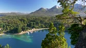 Патагония : View to Villa La Angostura, Argentina, Patagonia, Lake district. Blue bay, green trees and mountains. UHD, 4K