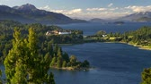 Аргентина : Nahuel Huapi Lake near Bariloche city in Patagonia, Southern Andes, Argentina. Green trees waving in the wind. Shot from Punto Panoramico. UHD Стоковые видеозаписи