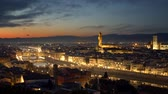 Мария : Florence, Italy. Panorama of the evening city after sunset. The Florence Cathedral, the Torre di Arnolfo tower, the Ponte Vecchio bridge across Arno is seen in this panorama. 4K Стоковые видеозаписи