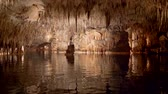 baleár : Cuevas del Drach on Majorca Island, Spain. Stabilized shot of lake in dragon cave from boat Stock mozgókép