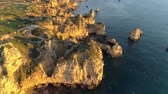 sea caves : Algarve, Portugal. Flying over the coast of Atlantic ocean in the afternoon sun. Transparent turquoise ocean water. Aerial shot, 4K