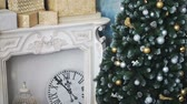 clock : Cristmas tree with toys on fireplace background