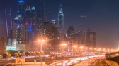 metro : DUBAI, UAE - SEPTEMBER 22, 2014: Timelapse view Dubai downtown and famous buildings Stock Footage