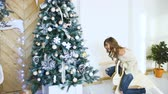 sensualidade : Young woman having fun and joy near christmas tree on party