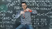 professor : Young scientist man make laboratory experiment in chemical and mathematical equations wall room