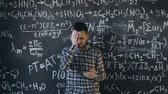 chalk : scientist man disappointed about problems experiment in chemical and mathematical equations room