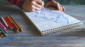 suluboya : Young woman artist painting scetch on paper notebook with pencil closeup Stok Video