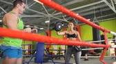 pontapé : Kickboxing trainer man train with young woman in boxing ring